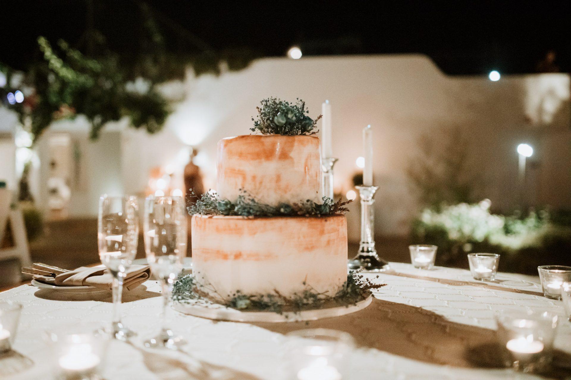 wedding cake white and orange lavender decorations
