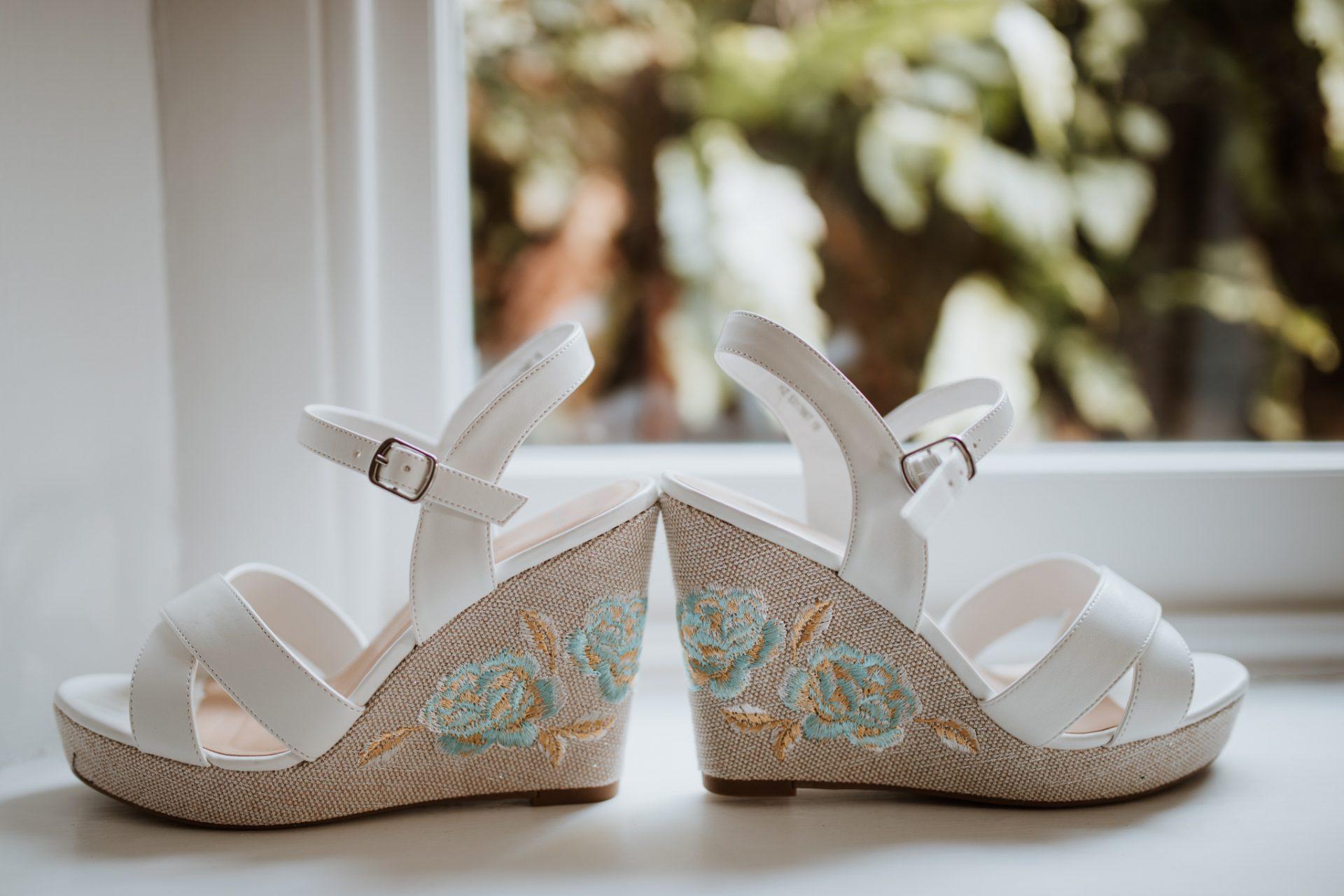 wedding shoes on the windowsill wedges