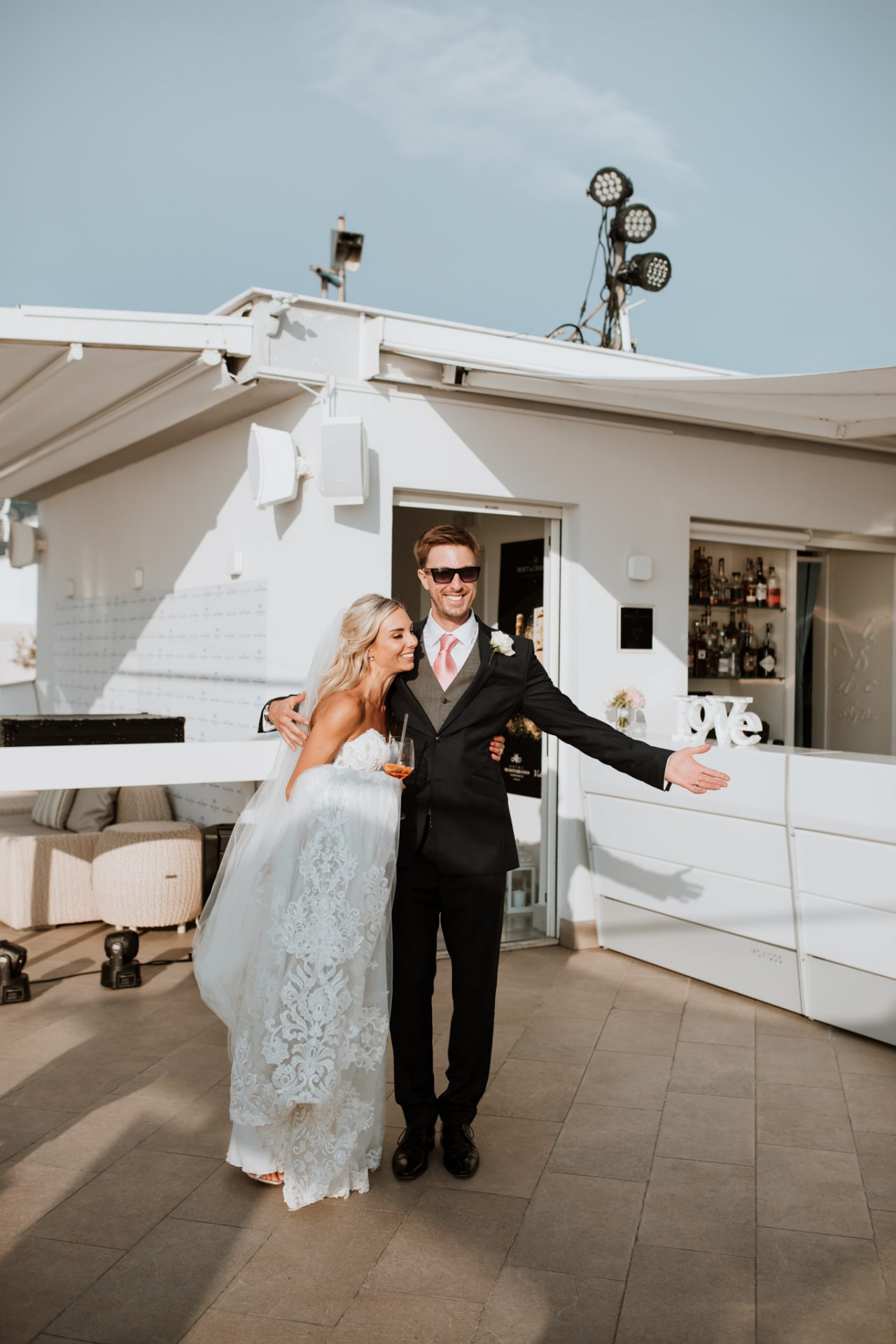 bride and groom's reaction to seeing their wedding breakfast set up