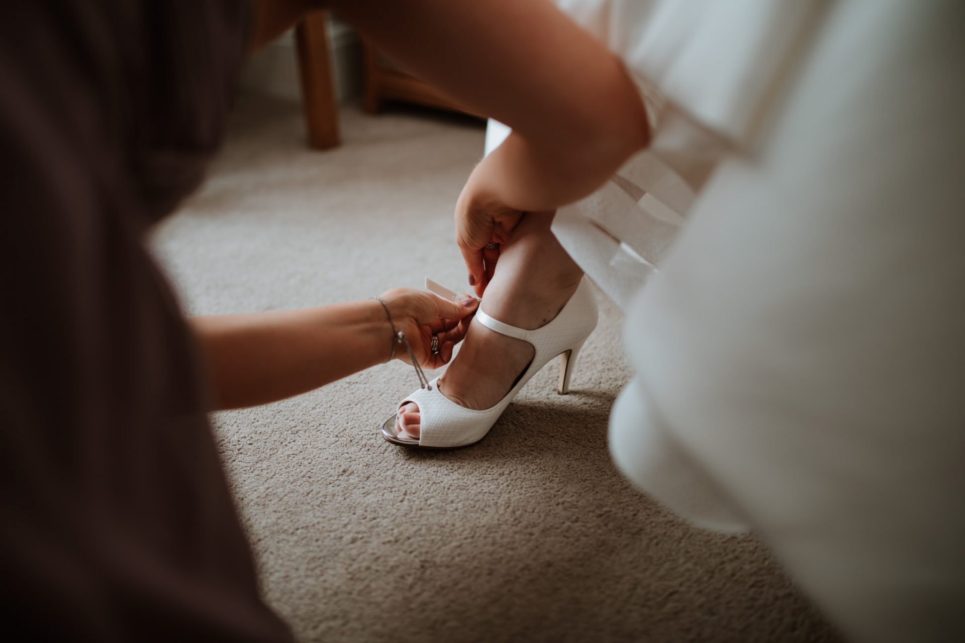 putting on the wedding shoes