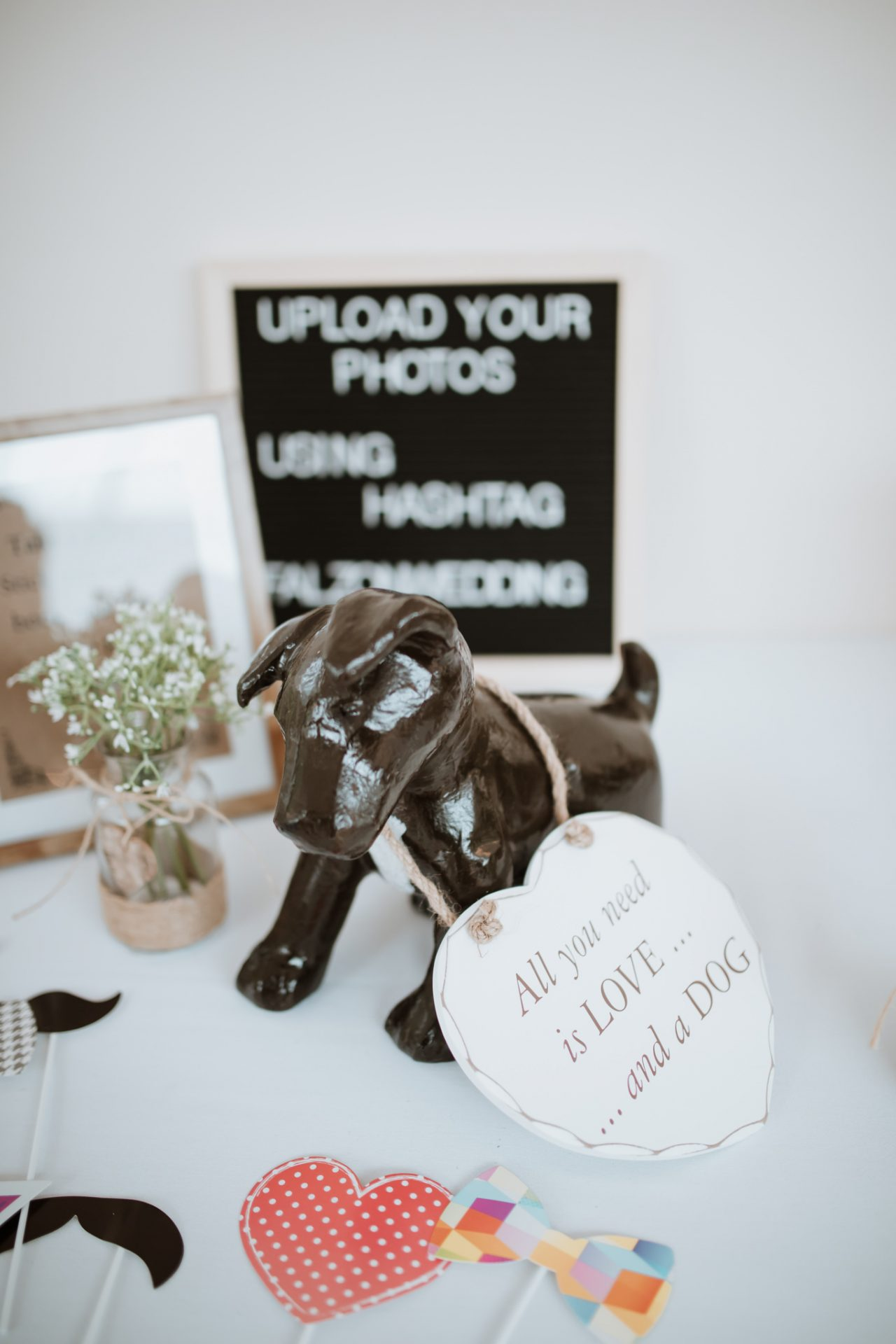 all you need is love and a dog statue wedding decoration