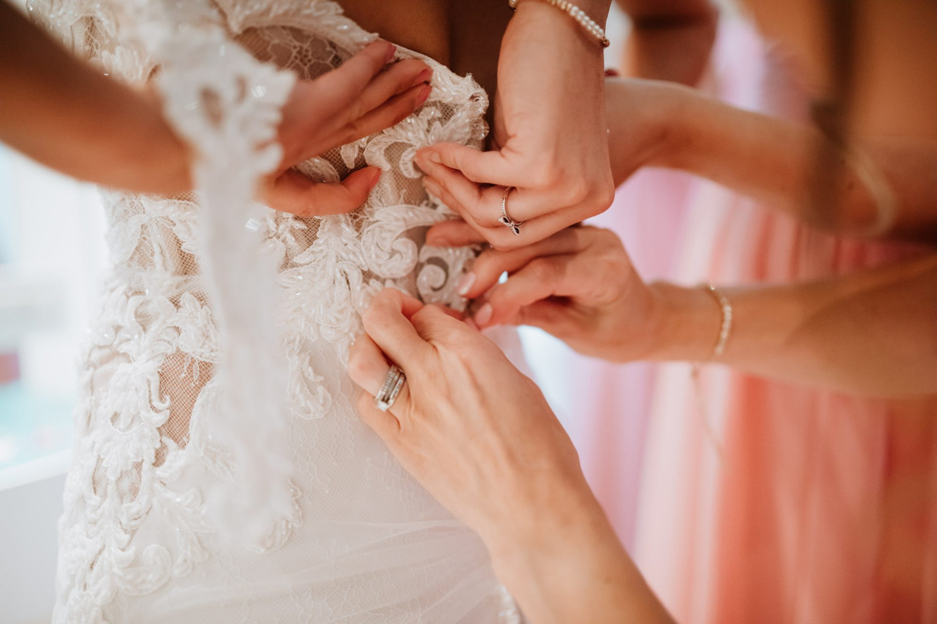 close up of the wedding dress being put on