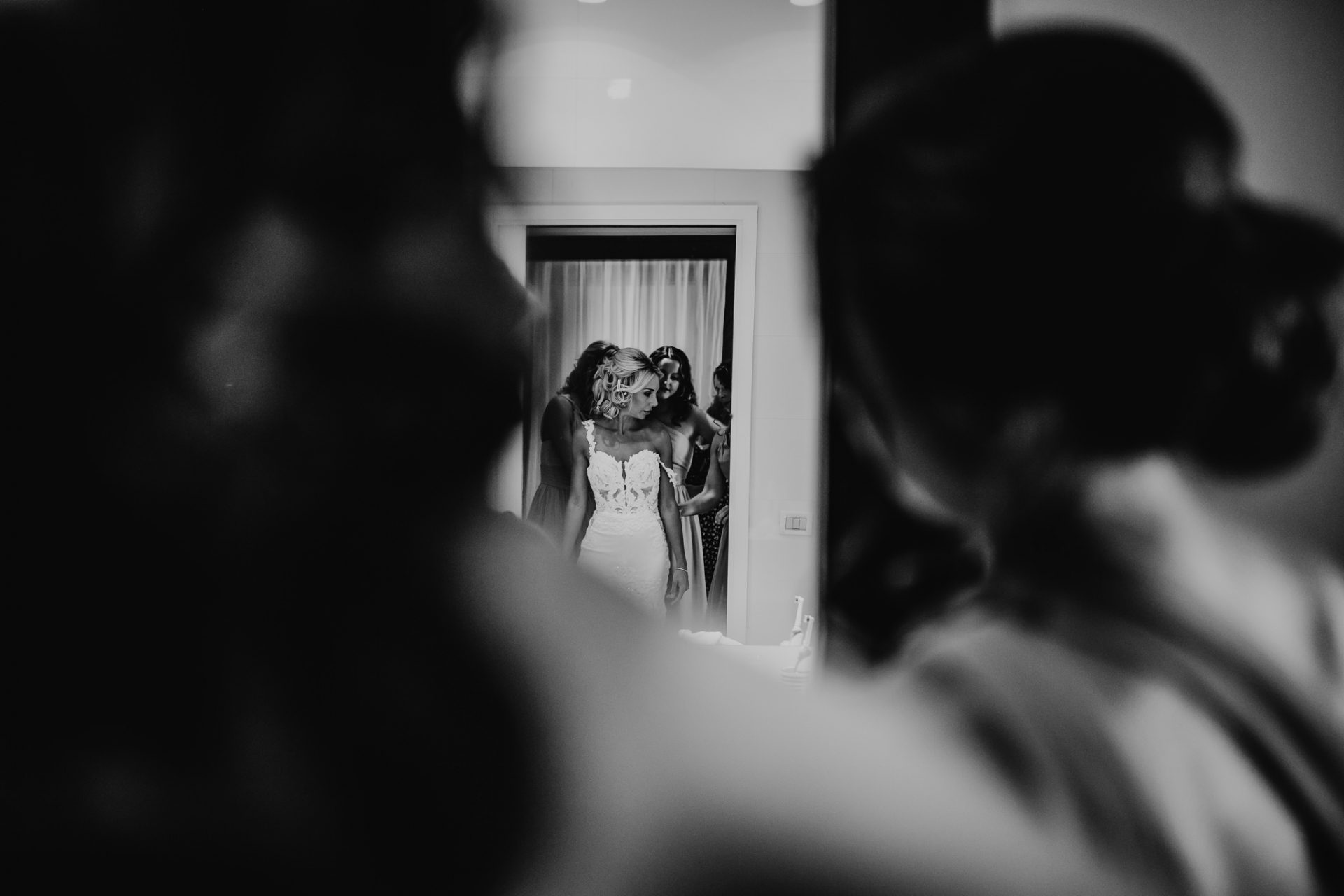 bride getting ready reflected in the mirror