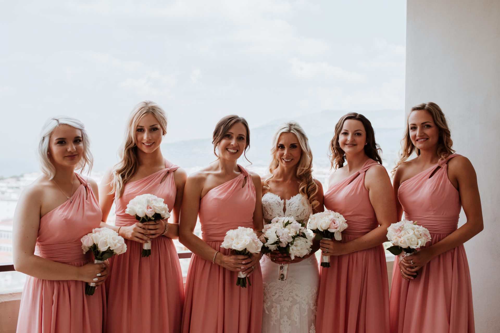 bride and bridesmaids on the balcony