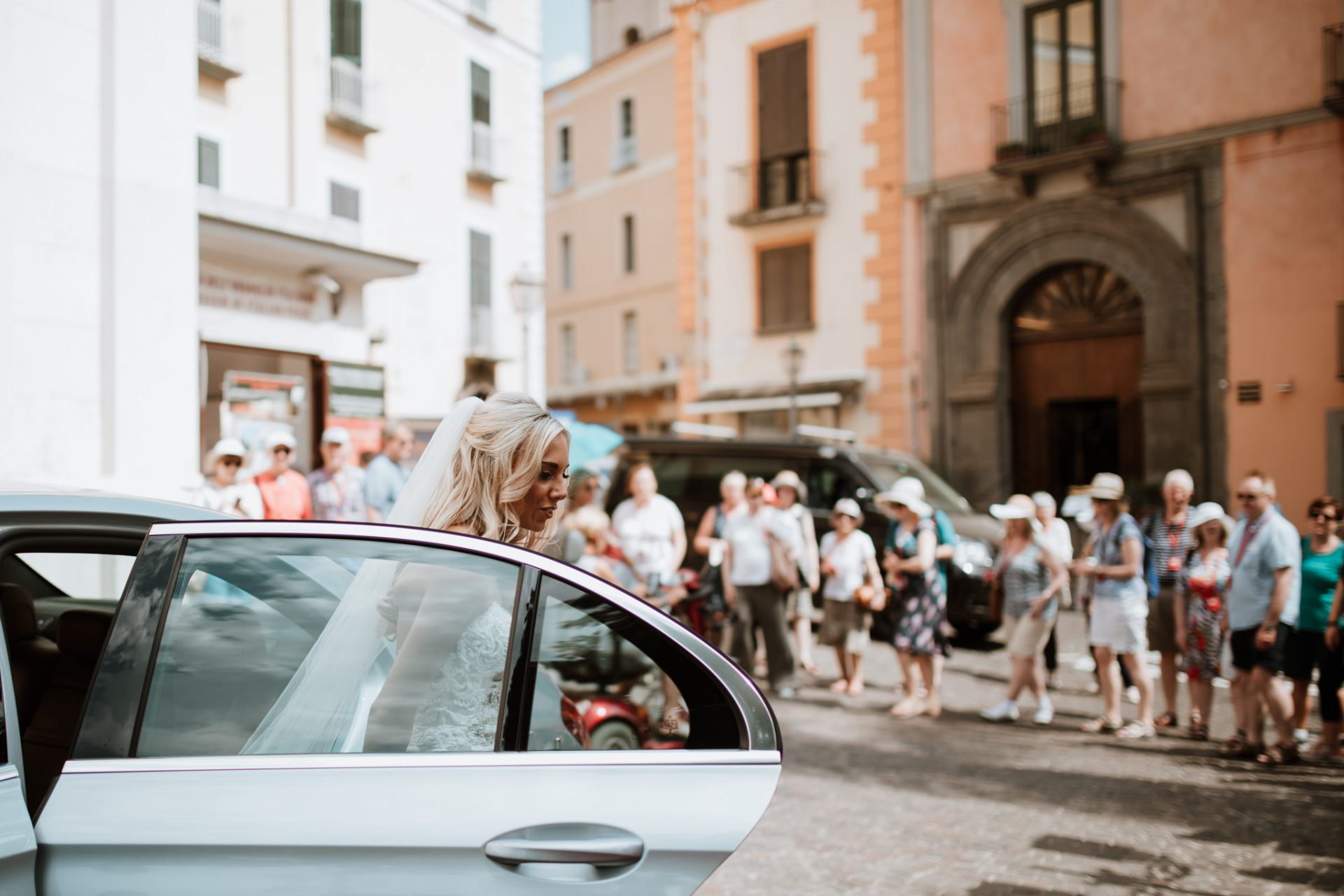 bride arriving to sorrento cloisters as tourists watch
