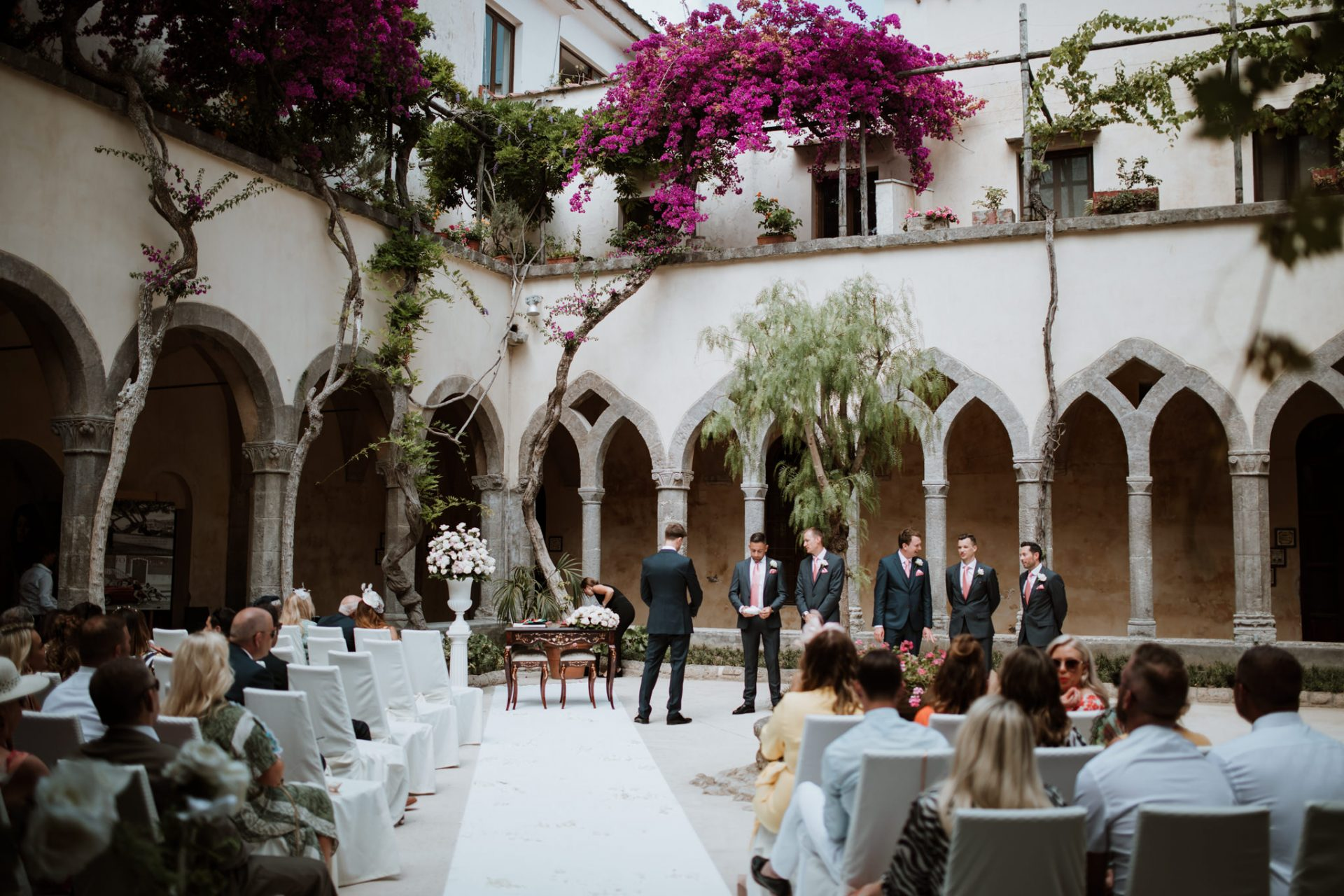 groom and groomsmen waiting in sorrento cloisters chiostro di san francesco