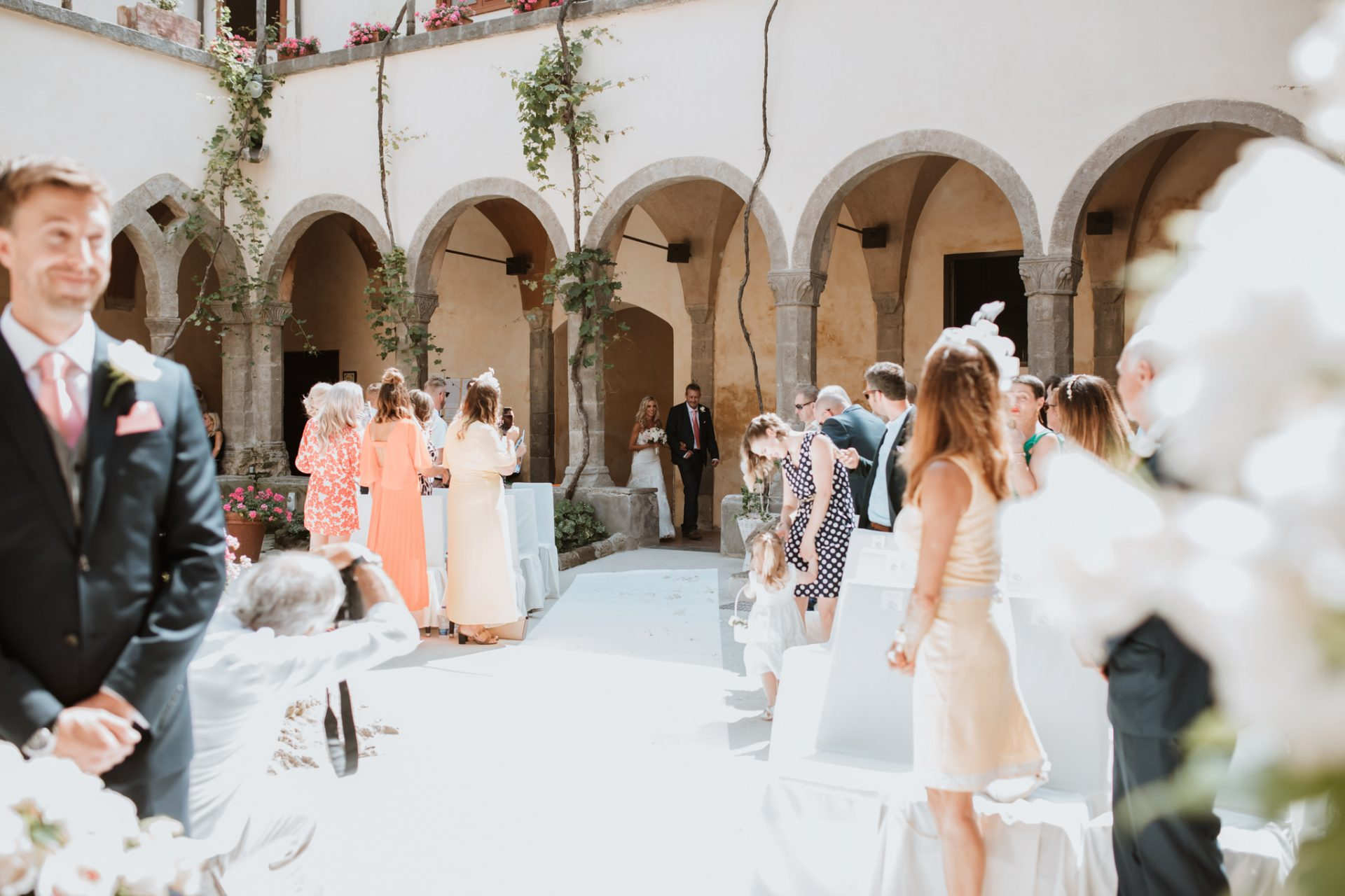 bride walking down the aisle with her father sorrento cloisters chiostro di san francesco