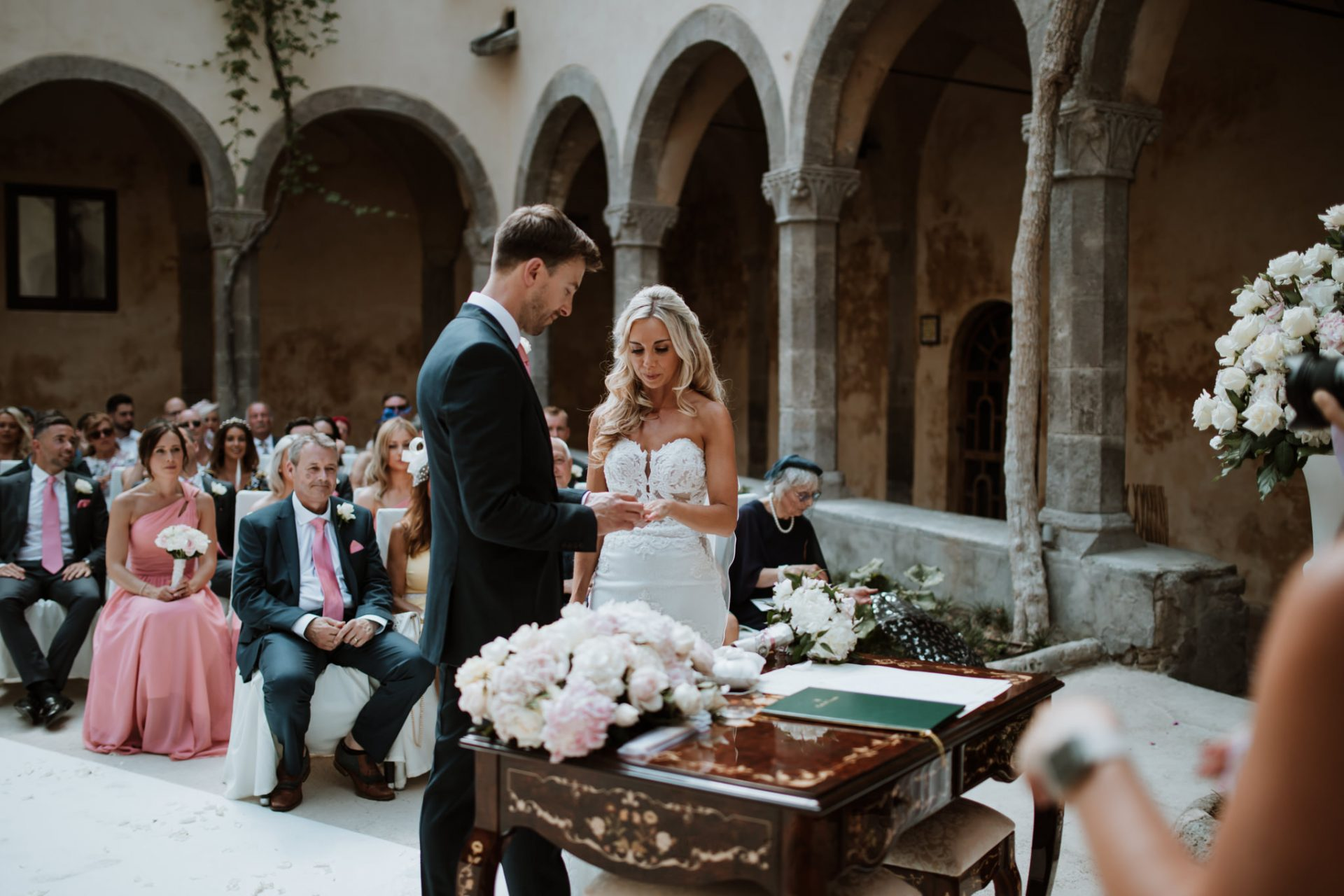 exchanging rings wedding ceremony sorrento cloisters chiostro di san francesco