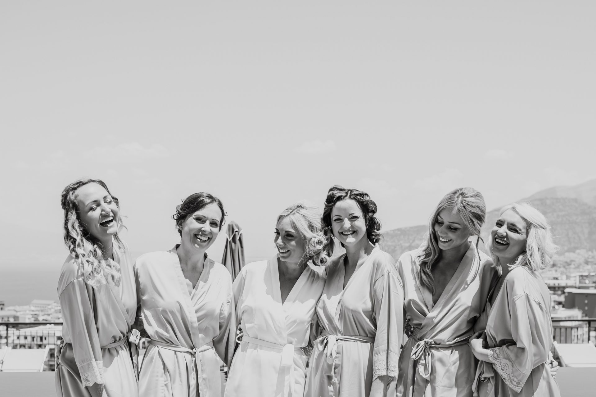 bridesmaids laughing on the rooftop
