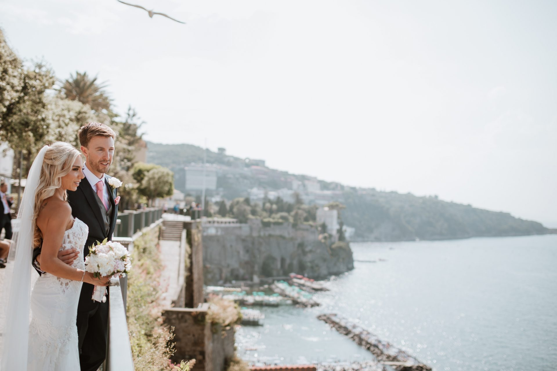 bride and groom looking out towards the sea sorrento destination wedding