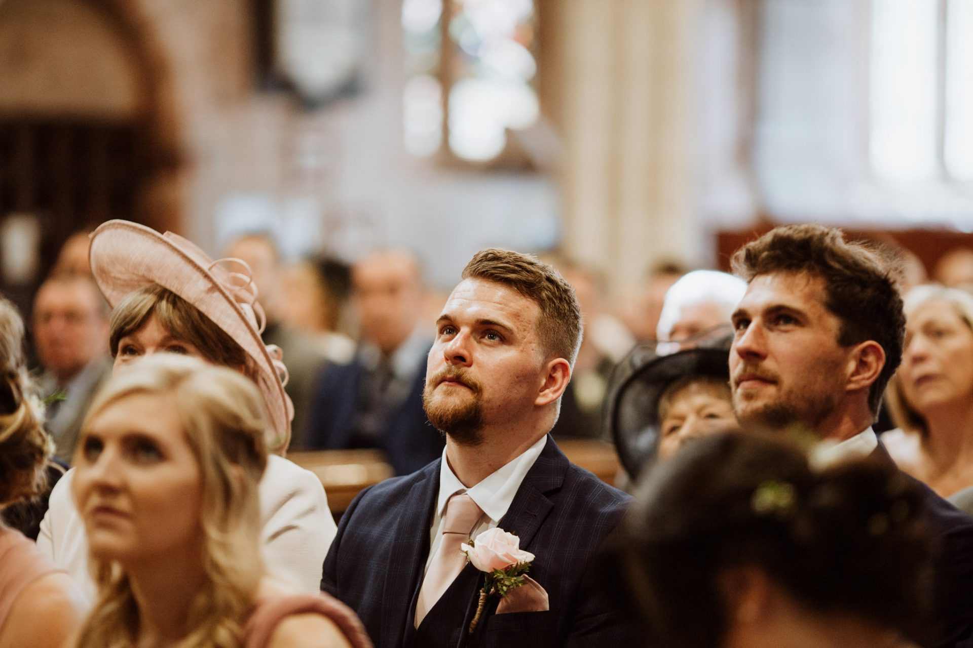teary eyed guest in church
