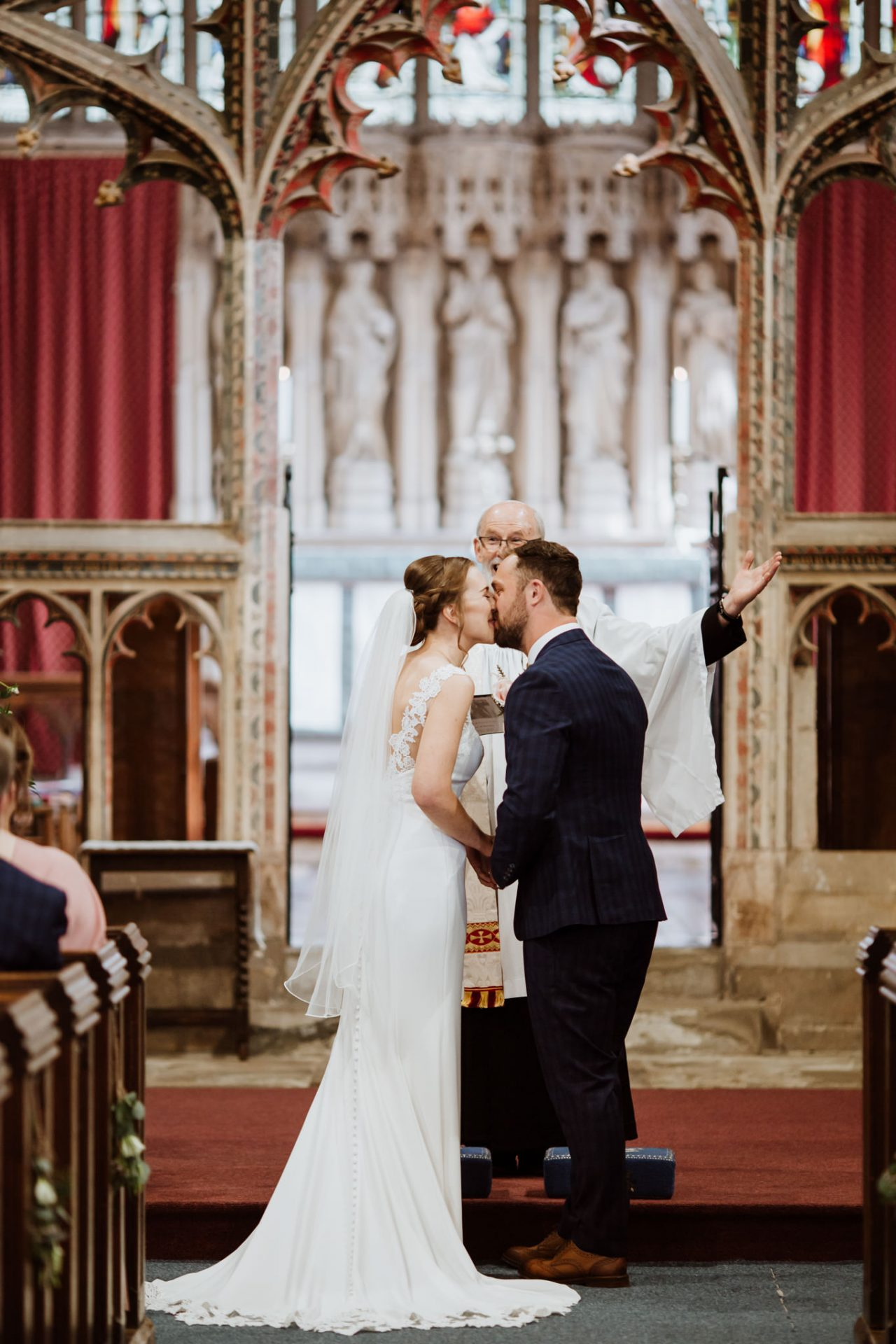 first kiss bride and groom wedding ceremony st mary's church berkeley