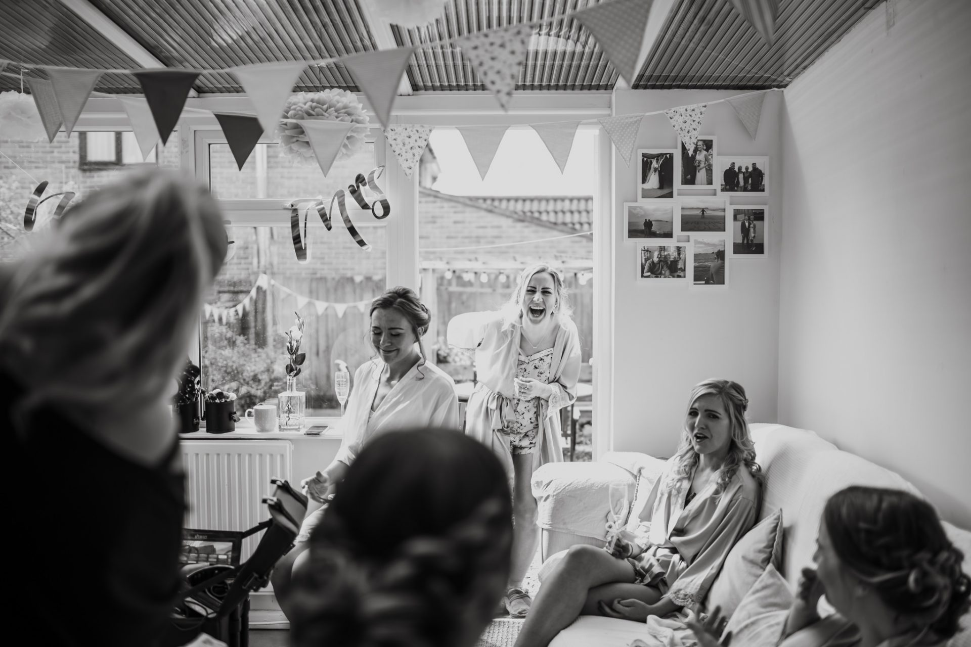 bridesmaids laughing getting ready