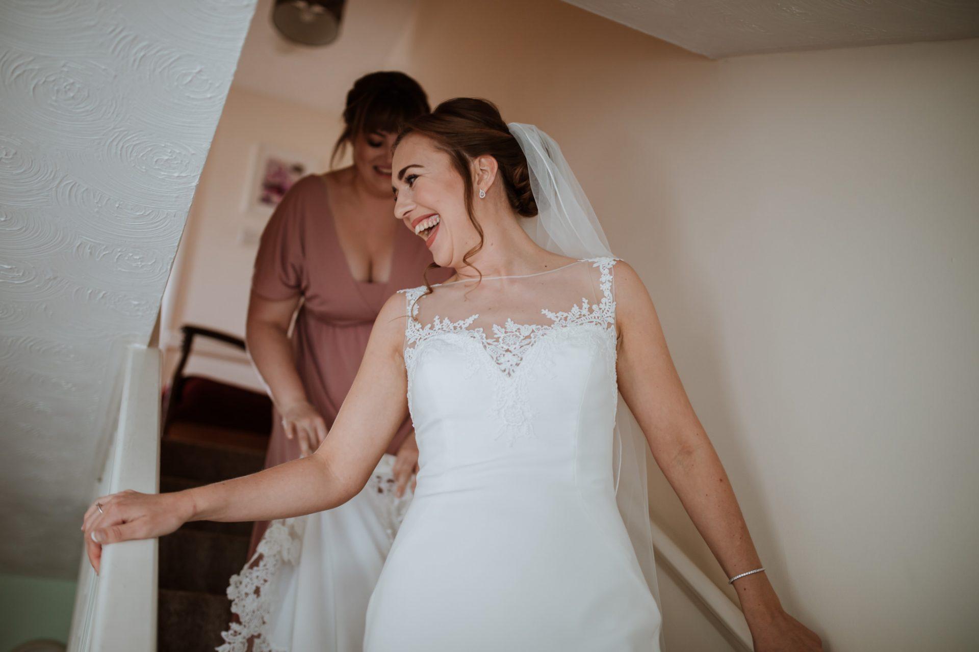 bride walking down first look