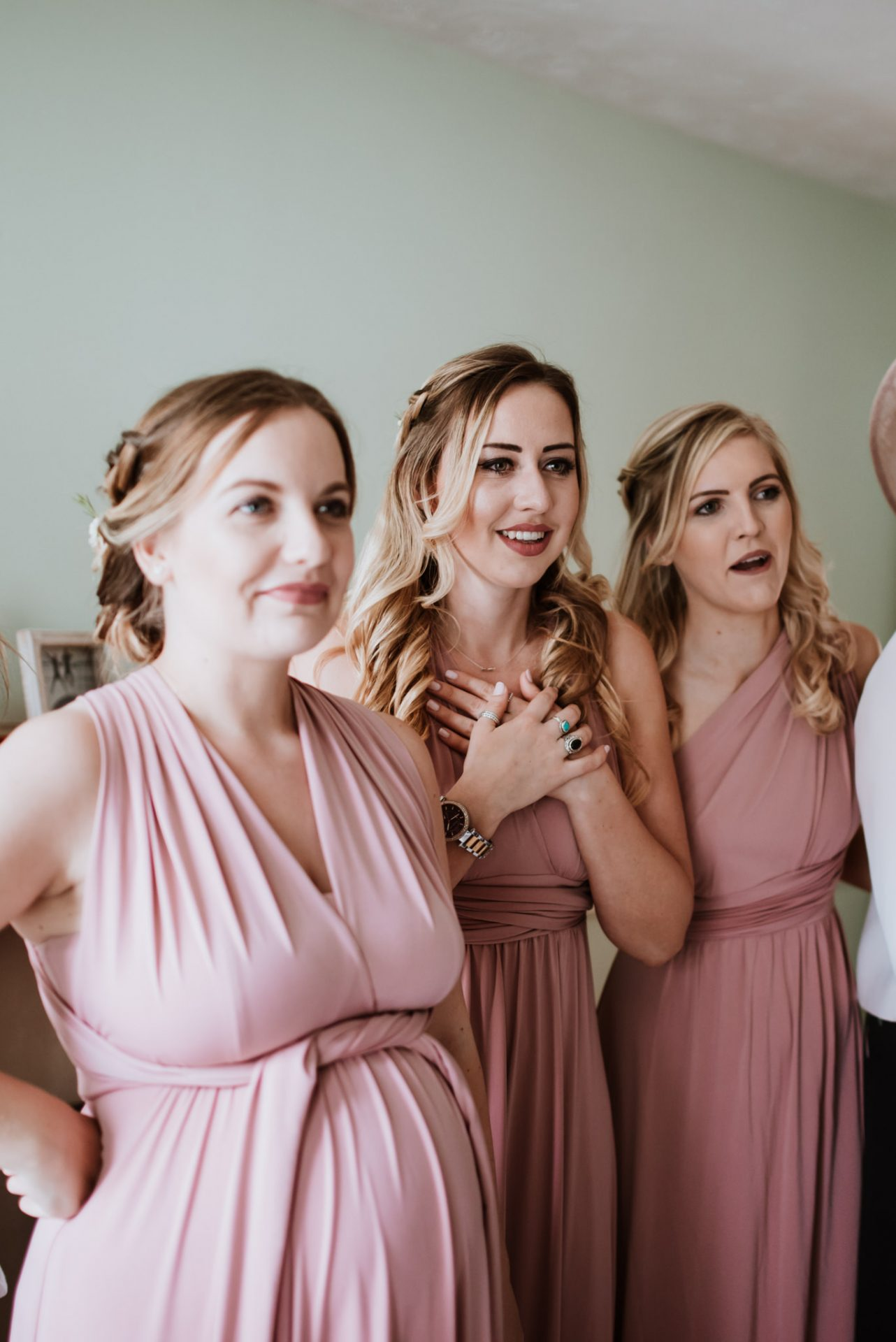 bridesmaids reaction to seeing the bride in her dress for the first time