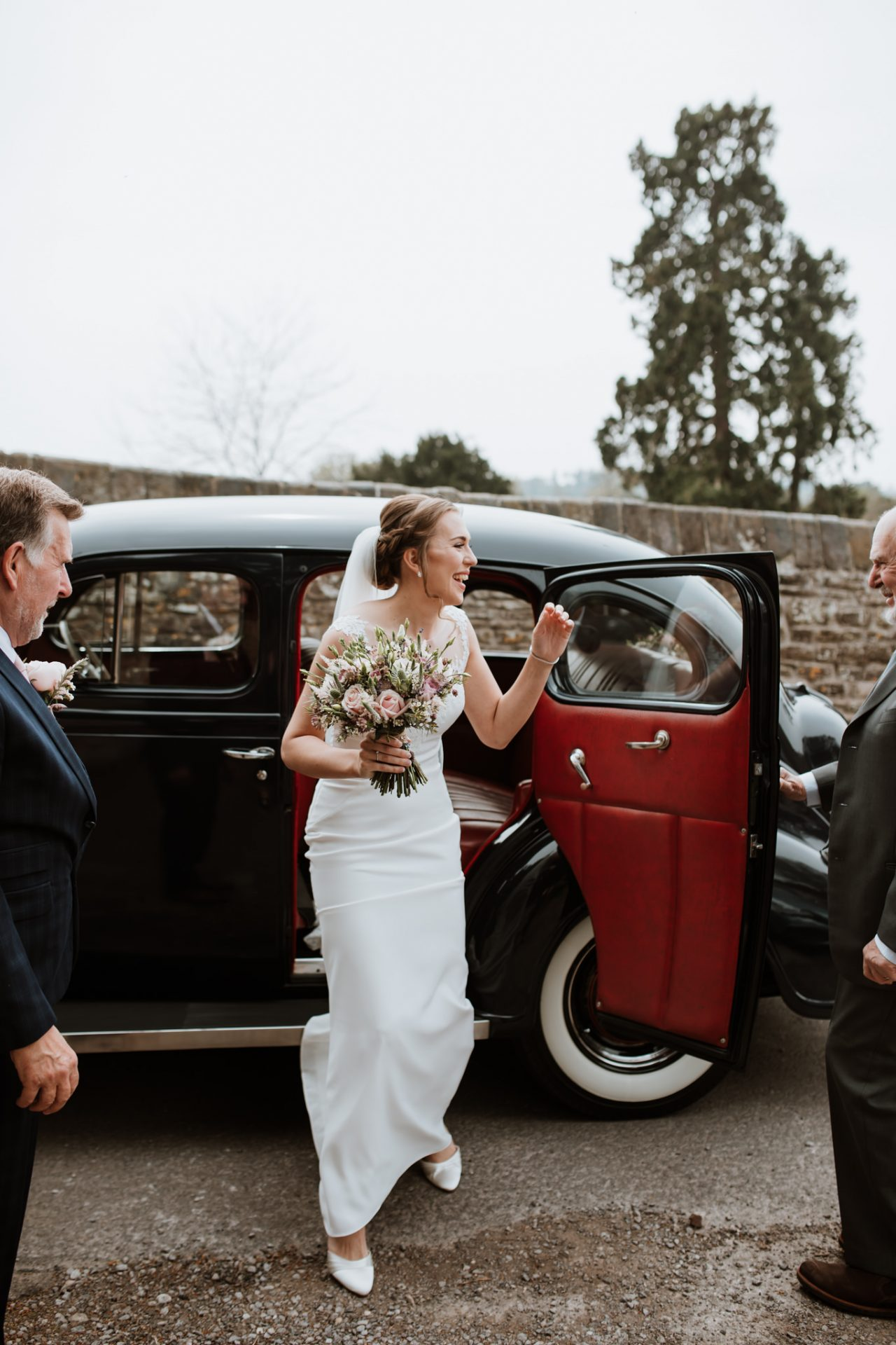 bride arriving to church in vintage car
