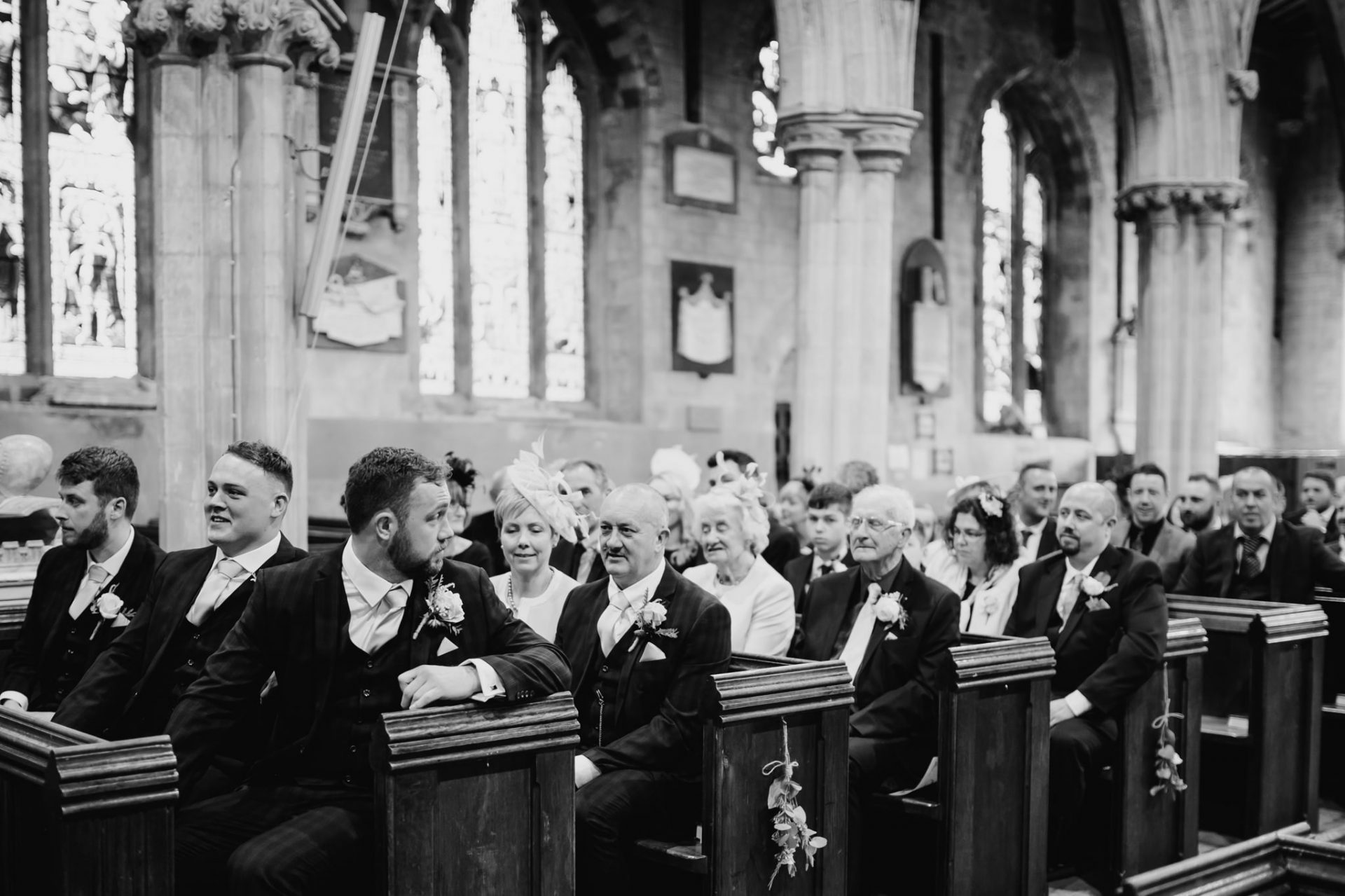 groom waiting in church for bride to arrive