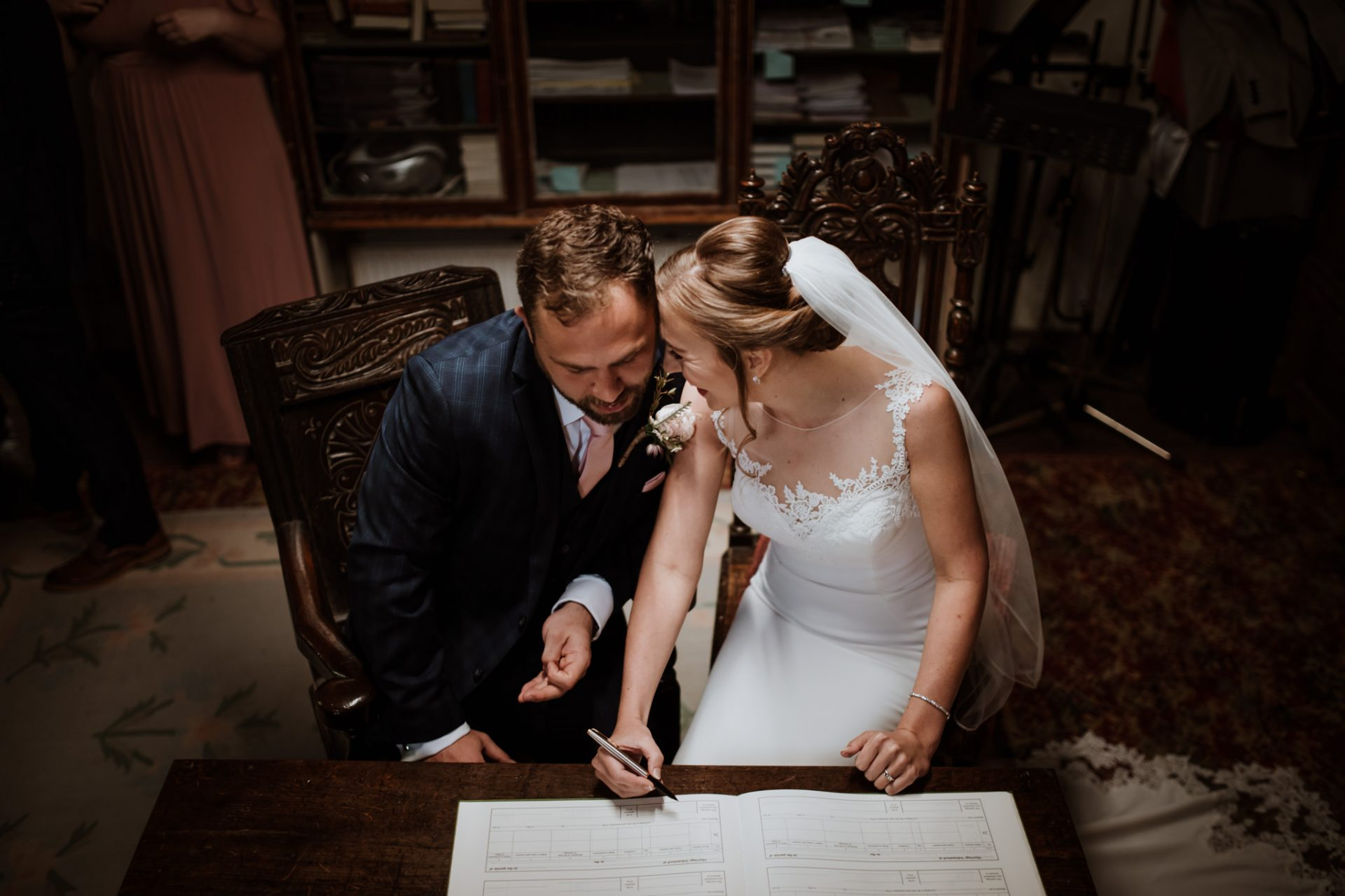 bride and groom sign the registry wedding ceremony st mary's church berkeley